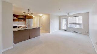 "Photo 1: 221 9500 ODLIN Road in Richmond: West Cambie Condo for sale in ""CAMBRIDGE PARK"" : MLS®# R2358525"