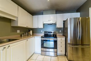 """Photo 2: 401 5765 GLOVER Road in Langley: Langley City Condo for sale in """"College Court"""" : MLS®# R2493254"""