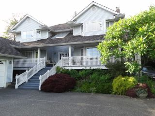 Photo 1: 823 ROCHESTER Avenue in Coquitlam: Coquitlam West House for sale : MLS®# V1064695