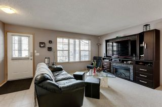 Photo 3: 104 3 EVERRIDGE Square SW in Calgary: Evergreen Row/Townhouse for sale : MLS®# A1143635