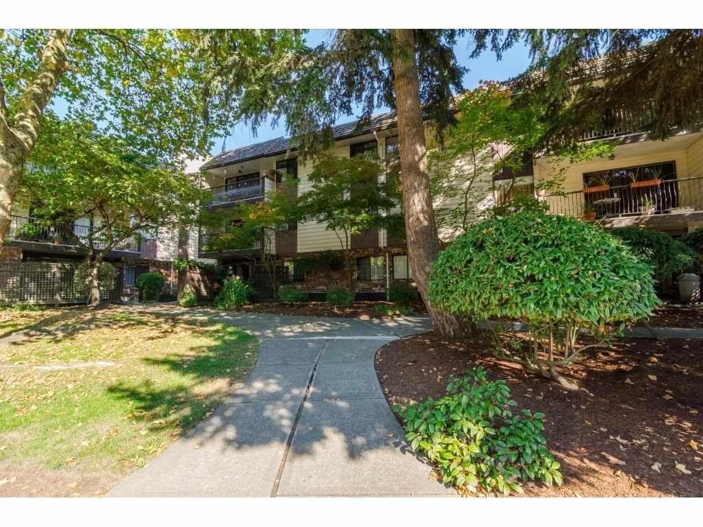 "Main Photo: 305 7426 138 Street in Surrey: East Newton Condo for sale in ""Glencoe Estates"" : MLS®# R2565557"