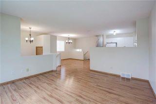 Photo 6: 13 BRIDLEGLEN Manor SW in Calgary: Bridlewood Detached for sale : MLS®# C4302730