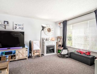 Photo 2: 20200 53 Avenue in Langley: Langley City Fourplex for sale : MLS®# R2589716