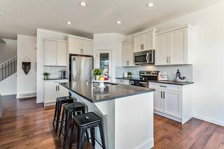 Photo 7: 28 Auburn Glen View SE in Calgary: Auburn Bay Detached for sale : MLS®# A1095232