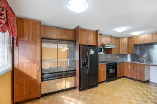 Photo 12: 128 Dovertree Place SE in Calgary: Dover Semi Detached for sale : MLS®# A1075565