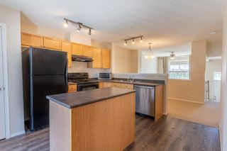 Photo 16: 119 Toscana Gardens NW in Calgary: Tuscany Row/Townhouse for sale : MLS®# A1121039