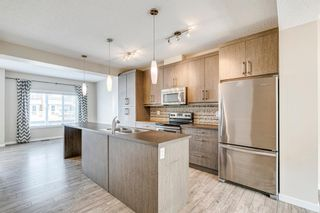Photo 2: 227 Marquis Lane SE in Calgary: Mahogany Row/Townhouse for sale : MLS®# A1130377