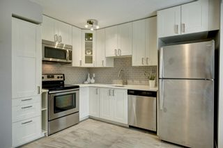 Main Photo: 7 123 Queensland Drive SE in Calgary: Queensland Row/Townhouse for sale : MLS®# A1127000