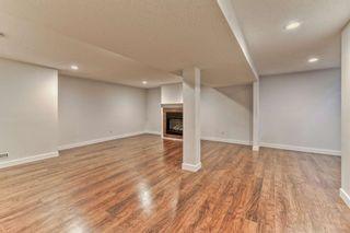 Photo 19: 316 Queen Alexandra Road SE in Calgary: Queensland Detached for sale : MLS®# A1104461