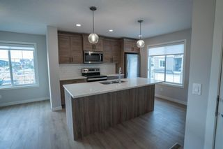 Photo 23: 1601 250 fireside Drive: Cochrane Row/Townhouse for sale : MLS®# A1143826