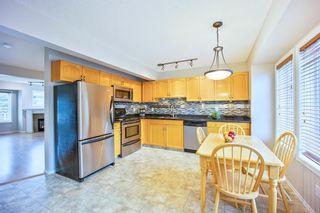 Photo 10: 678 Regal Park NE in Calgary: Renfrew Row/Townhouse for sale : MLS®# A1103366