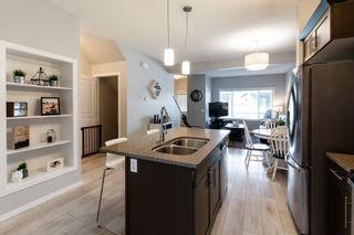 Photo 3: 17 8209 217 Street in Edmonton: Zone 58 Townhouse for sale : MLS®# E4255078