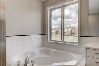 Photo 32: 48 Moreuil Court SW in Calgary: Garrison Woods Detached for sale : MLS®# A1104108