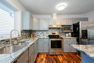 Photo 17: 88 Strathlorne Crescent SW in Calgary: Strathcona Park Detached for sale : MLS®# A1097538