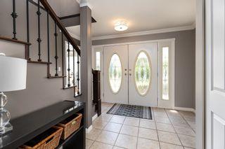 "Photo 3: 8110 164 Street in Surrey: Fleetwood Tynehead House for sale in ""FLEETWOOD PARK"" : MLS®# R2610443"