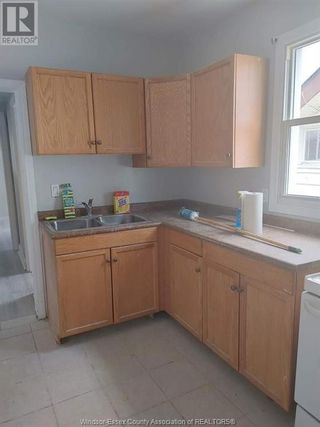 Photo 1: 900 ELSMERE Unit# A in Windsor: House for lease : MLS®# 21002807