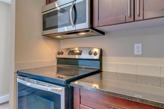 Photo 14: 9302 403 MACKENZIE Way SW: Airdrie Apartment for sale : MLS®# A1032027