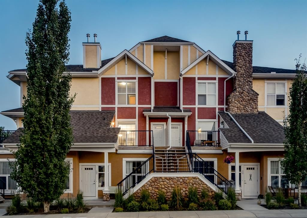 Main Photo: 106 WEST SPRINGS Road SW in Calgary: West Springs Row/Townhouse for sale : MLS®# A1128292