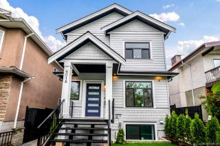 Photo 1: 6018 DUMFRIES Street in Vancouver: Knight 1/2 Duplex for sale (Vancouver East)  : MLS®# R2597312