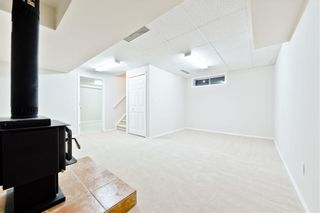 Photo 18: 167 BRIDLEWOOD CM SW in Calgary: Bridlewood House for sale