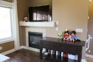 Photo 13: 84 BRIDLERIDGE Manor SW in Calgary: Bridlewood Row/Townhouse for sale : MLS®# A1029938