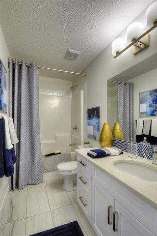 Photo 14: 13 Crestbrook Way SW in Calgary: Crestmont Detached for sale : MLS®# A1140042