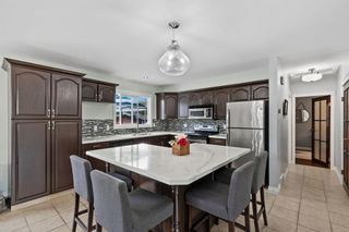 Photo 5: 432 Woodland Crescent SE in Calgary: Willow Park Detached for sale : MLS®# A1147020
