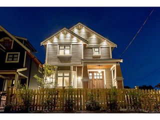 Photo 1: 1276 E 14TH Avenue in Vancouver: Mount Pleasant VE 1/2 Duplex for sale (Vancouver East)  : MLS®# V1085229