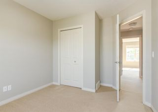Photo 18: 217 Cranberry Park SE in Calgary: Cranston Row/Townhouse for sale : MLS®# A1127199