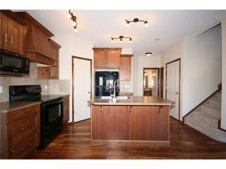 Photo 10: 103 WEST POINTE Court: Cochrane House for sale : MLS®# C4042878