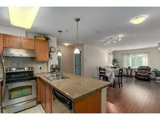 """Photo 4: 108 2373 ATKINS Avenue in Port Coquitlam: Central Pt Coquitlam Condo for sale in """"CARMANDY"""" : MLS®# V1136914"""