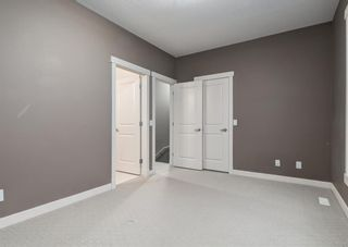 Photo 22: 106 WEST SPRINGS Road SW in Calgary: West Springs Row/Townhouse for sale : MLS®# A1128292