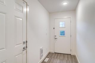 Photo 4: 26 Walden Path SE in Calgary: Walden Row/Townhouse for sale : MLS®# A1150534