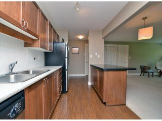 """Photo 7: 118 32725 GEORGE FERGUSON Way in Abbotsford: Abbotsford West Condo for sale in """"Uptown"""" : MLS®# F1417772"""