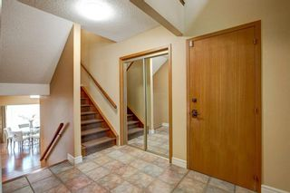 Photo 6: 131 Strathbury Bay SW in Calgary: Strathcona Park Detached for sale : MLS®# A1130947