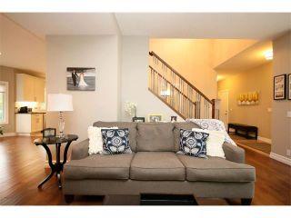 Photo 6: 156 GLENEAGLES Close: Cochrane House for sale : MLS®# C4018066