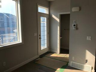 Photo 25: 23 Sunrise Heights: Cochrane Duplex for sale : MLS®# A1017998