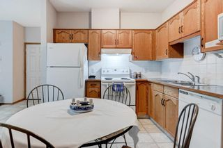 Photo 11: 111 72 Quigley Drive: Cochrane Apartment for sale : MLS®# A1137797