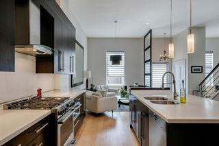 Photo 14: 100 18 Avenue SE in Calgary: Mission Row/Townhouse for sale : MLS®# A1100251