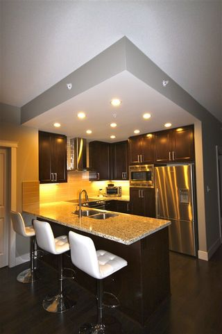 "Photo 7: 806 1415 PARKWAY Boulevard in Coquitlam: Westwood Plateau Condo for sale in ""Casade"" : MLS®# R2010040"