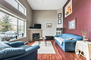 Photo 7: 6 Crystal Shores Cove: Okotoks Row/Townhouse for sale : MLS®# A1080376