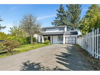 Photo 2: 7162 129A Street in Surrey: West Newton House for sale : MLS®# R2569949