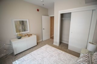 Photo 16: Gorgeous corner unit with wrap around balcony. 1 Underground parking stall included. Pet friendly building.