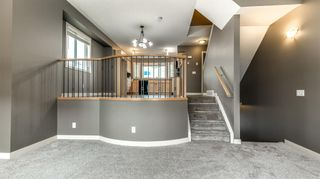Photo 3: 322 STRATHCONA Circle: Strathmore Row/Townhouse for sale : MLS®# A1062411