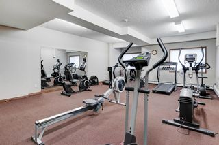 Photo 23: 111 72 Quigley Drive: Cochrane Apartment for sale : MLS®# A1137797