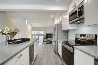Photo 8: 18 23 GLAMIS Drive SW in Calgary: Glamorgan Row/Townhouse for sale : MLS®# C4293162
