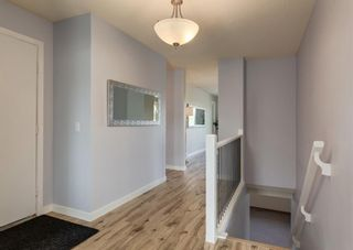 Photo 3: 42 140 Strathaven Circle SW in Calgary: Strathcona Park Semi Detached for sale : MLS®# A1146237
