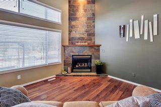 Photo 2: 105 Rocky Ridge Court NW in Calgary: Rocky Ridge Row/Townhouse for sale : MLS®# A1069587
