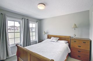 Photo 18: 314 Ascot Circle SW in Calgary: Aspen Woods Row/Townhouse for sale : MLS®# A1111264