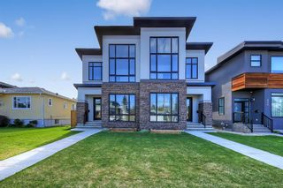 Main Photo: 211 18 Street NW in Calgary: West Hillhurst Semi Detached for sale : MLS®# A1118670